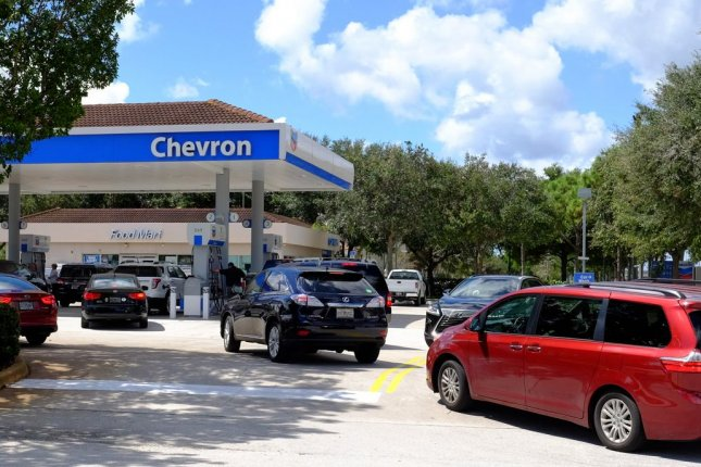 Retail gasoline prices spike in response to OPEC-fueled rally in crude oil prices, though some analysts are questioning whether or not the trend will hold. Photo by Gary I Rothstein/UPI.