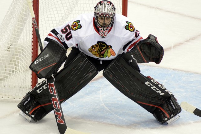 Chicago Blackhawks goalie Corey Crawford (50) braces himself for the face-off. File photo by Archie Carpenter/UPI
