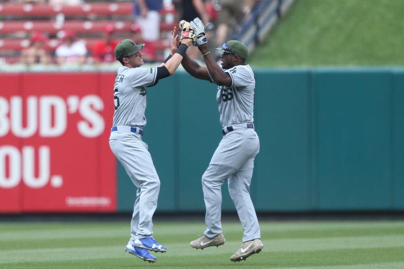 Los Angeles Dodgers' Cody Bellinger (L) and Yasiel Puig celebrate a win. File photo by Bill Greenblatt/UPI