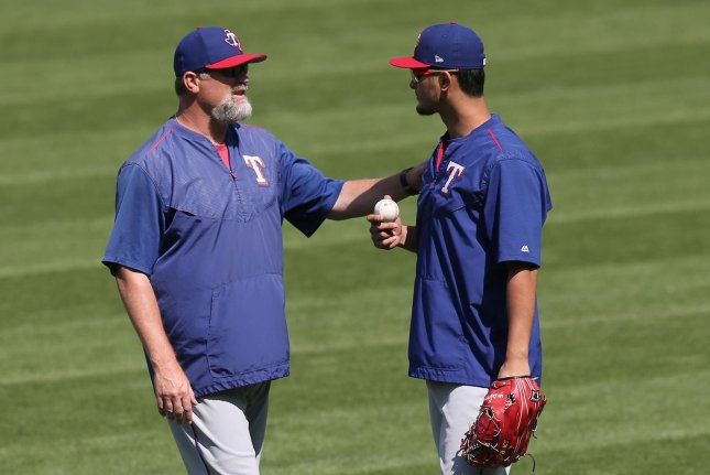 Texas Rangers pitching coach Douglas Brocail (L) talks with Yu Darvish prior to their game against the Cleveland Indians at Progressive Field in Cleveland, Ohio on June 29, 2017. File photo by Aaron Josefczyk/UPI