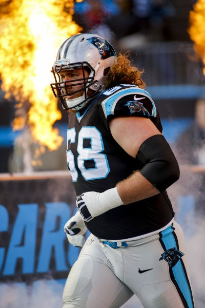 Carolina Panthers guard Andrew Norwell runs onto the field prior to a game against the Tampa Bay Buccaneers in 2016. Norwell reportedly will sign with the Jacksonville Jaguars in free agency. Photo by Nell Redmond/UPI