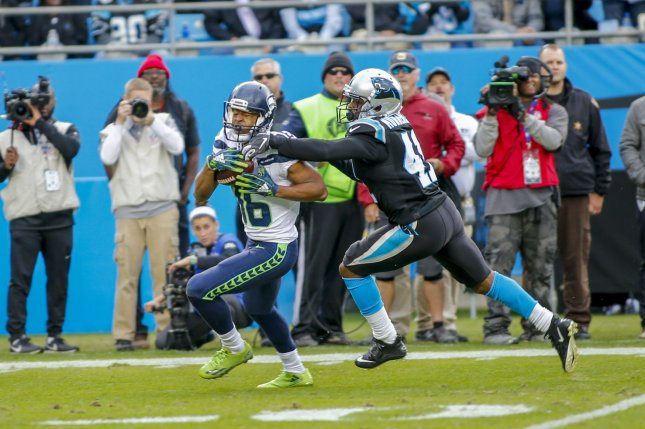 36fc41a1f Seattle Seahawks wide receiver Tyler Lockett (L) makes a 43-yard catch  against Carolina Panthers defensive back Captain Munnerlyn to give Seattle  an ...