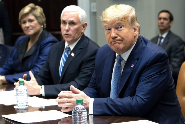 President Donald Trump and Vice President Mike Pence meet Tuesday with insurance company representatives in the Roosevelt Room of the White House in Washington, D.C. Photo by Kevin Dietsch/UPI