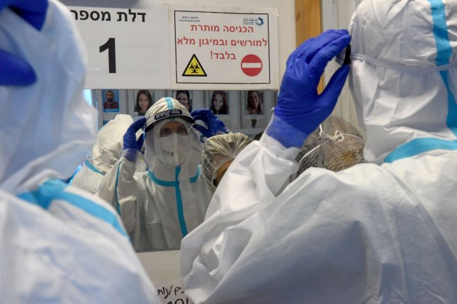 Medical staff dress in full protective suits before entering the COVID-19 ward at Shaare Tzedek Medical Center in Jerusalem on Tuesday. Photo by Debbie Hill/UPI