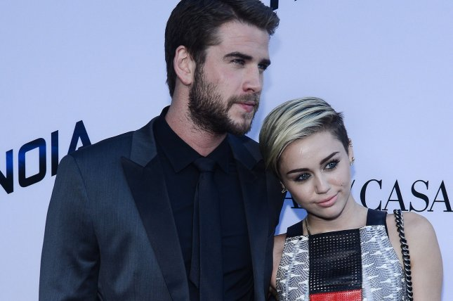 Liam Hemsworth and Miley Cyrus. UPI/Jim Ruymen