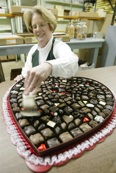 Kitty Klinkhardt shines up eight pounds of chocolate with a paint brush. UPI Photo/Bill Greenblatt)
