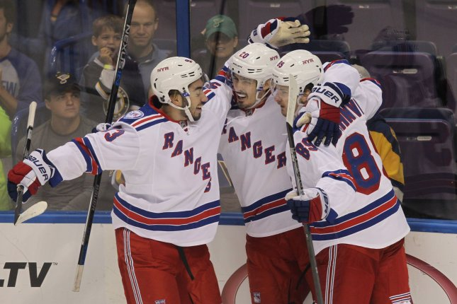 New York Rangers Chris Kreider (20) celebrates his first period goal against the St. Louis Blues with teammates Mika Zibanejad of Sweden (L) and Pavel Buchnevich of Russia in the first period at the Scottrade Center in St. Louis on October 15, 2016. File photo by Bill Greenblatt/UPI