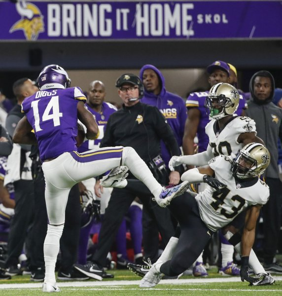 Minnesota Vikings wide receiver Stefon Diggs catches a touchdown pass against New Orleans Saints free safety Marcus Williams (center) in the second half of the NFC Divisional round playoff game at U.S. Bank Stadium in Minneapolis on Sunday. Photo by Kamil Krzaczynski/UPI