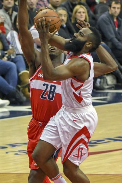 Houston Rockets guard James Harden (13) scores against Washington Wizards center Ian Mahinmi (28) in the first half at Capital One Arena in Washington, D.C. on December 29, 2017. Photo by Mark Goldman/UPI