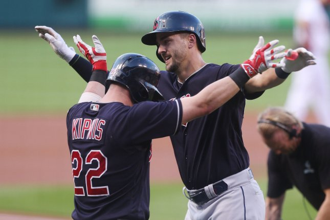 Cleveland Indians' Lonnie Chisenhall celebrates his solo home run with Jason Kipnis at home plate in the second inning on June 27 at Busch Stadium in St. Louis. Photo by Bill Greenblatt/UPI