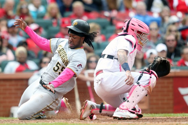 Pittsburgh Pirates first baseman Josh Bell (L) had a career-high four hits in a win against the St. Louis Cardinals on Sunday in St. Louis. Photo by Bill Greenblatt/UPI
