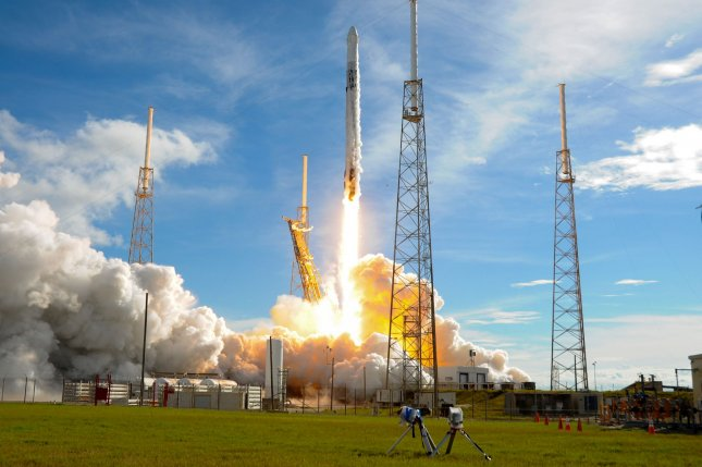 The SpaceX Falcon 9 rocket launches a Dragon spacecraft from the Cape Canaveral Air Force Station on Thursday. Photo by Joe Marino-Bill Cantrell/UPI