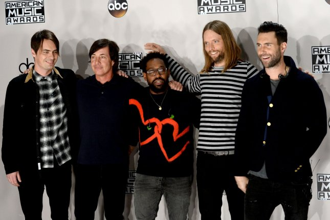 Left to right, Mickey Madden, Matt Flynn, PJ Morton, James Valentine and Adam Levine, of Maroon 5, appear backstage during the 2016 American Music Awards on November 2016. Madden was arrested in Los Angeles and has posted bail at $50,000. File Photo by Jim Ruymen/UPI