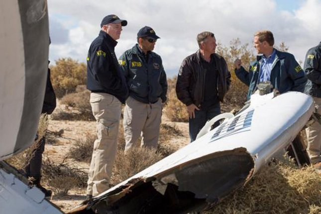 The National Transportation Safety Board investigates the crash site of the Virgin Galactic prototype space tourism rocket in Mojave, Calif., on November 2, 2014, two days after the aircraft crashed. File Photo courtesy of the NTSB