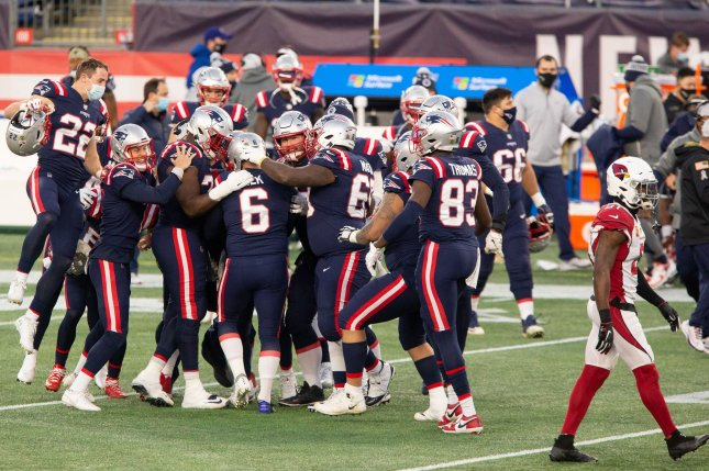 New England Patriots players congratulate kicker Nick Folk (6) after his 50-yard game-winning field goal against the Arizona Cardinals in the fourth quarter Sunday at Gillette Stadium in Foxborough, Mass. Photo by Matthew Healey/UPI