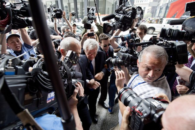 Former U.S. House Speaker Dennis Hastert (C) is surrounded by reporters as he arrives at federal court in Illinois for his arraignment on charges that he evaded banking regulations and lied about it to the FBI, on June 9, 2015 in Chicago. Monday, a man who claims he was molested by Hastert while a student at an Illinois high school during the 1970s filed a lawsuit in an attempt to collect nearly $2 million in hush money he claims Hastert promised to pay him. File Photo by Brian Kersey/UPI