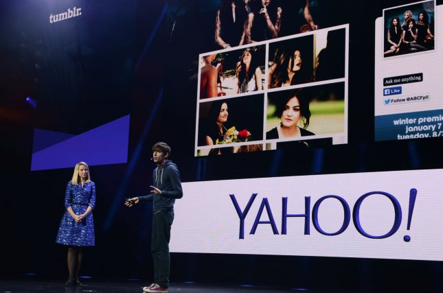 An SEC filing by Yahoo! on Thursday reveals the company was aware of attempts to breach its systems long before the hack of 500 million accounts announced in September, which may affect the price the company can sell itself to Verizon for. Above, Marissa Mayer, CEO, President and Director of Yahoo!, listens to David Karp, CEO of Tumblr, during her key note address at the 2014 International CES in Las Vegas. File photo by Molly Riley/UPI