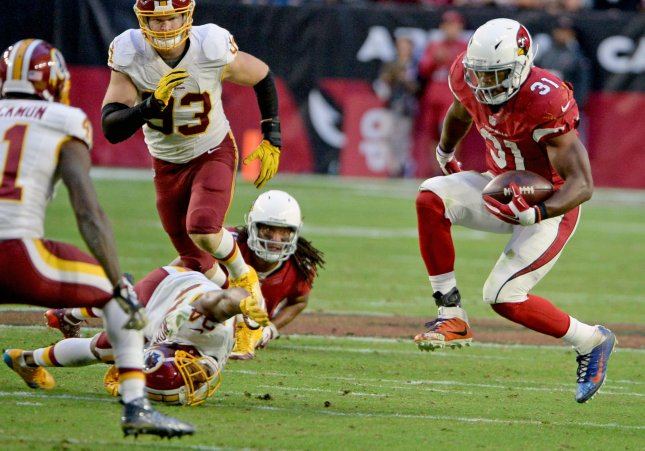 84a8e36e3 Arizona Cardinals  David Johnson (R) leaps as he changes direction in the  fourth quarter of the Cardinals-Washington Redskins game at University of  Phoenix ...