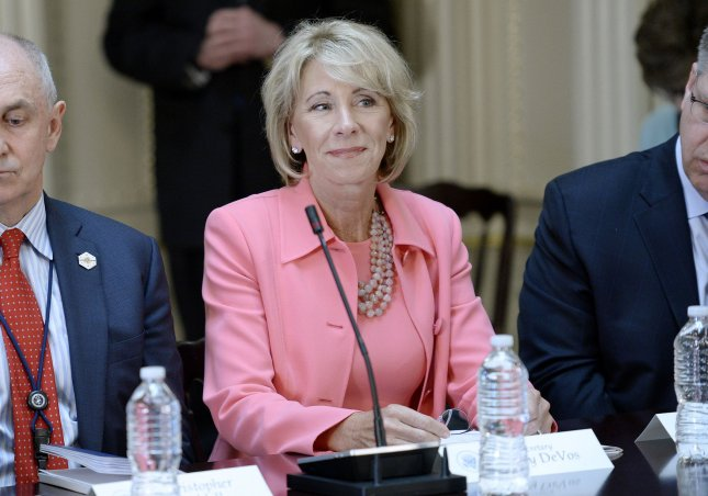 Education Secretary Betsy DeVos rolled back protections for student loan borrowers enacted at he end of the Obama administration in a letter to Federal Student Aid chief James W. Runcie. Pool photo by Olivier Douliery/UPI