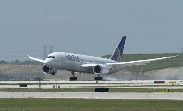 A Boeing 787 Dreamliner lands at O'Hare International Airport in Chicago on May 20, 2013. On Thursday, United issued new regulations for bringing emotional support animals on board. File Photo by Brian Kersey/UPI