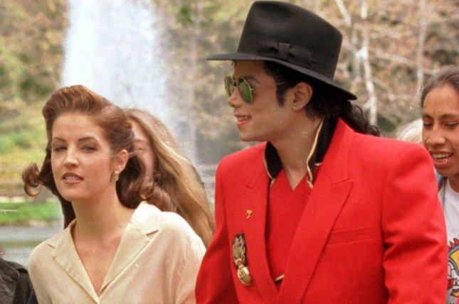 Michael Jackson (R) is pictured in April 1995 with Lisa Marie Presley in Los Angeles. On August 1, 1994, Presley confirmed rumors that she had married the pop star May 26 in the Dominican Republic. The couple divorced less than two years later. File Photo by Jim Ruymen/UPI