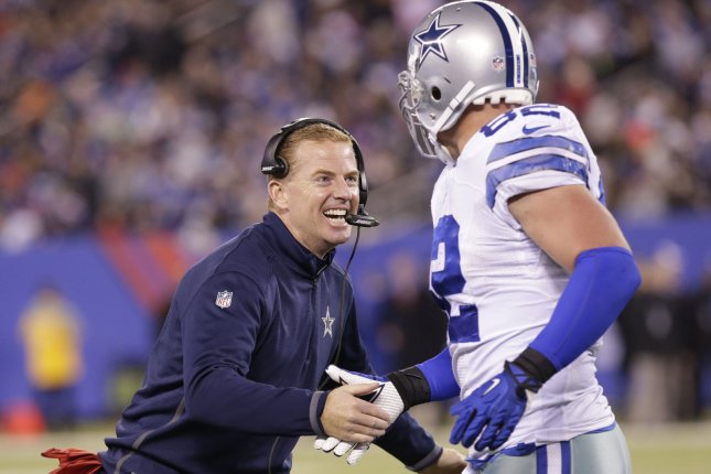 Dallas Cowboys head coach Jason Garrett (L) celebrates with former Cowboys tight end Jason Witten (82) after the Cowboys score a touchdown in the second quarter against the New York Giants in Week 12 of the NFL season on November 23, 2014 at MetLife Stadium in East Rutherford, New Jersey. File photo by John Angelillo/UPI