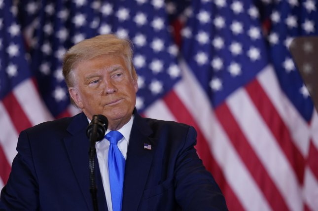 President Donald Trump speaks to supporters at the White House early Wednesday. Photo by Chris Kleponis/UPI
