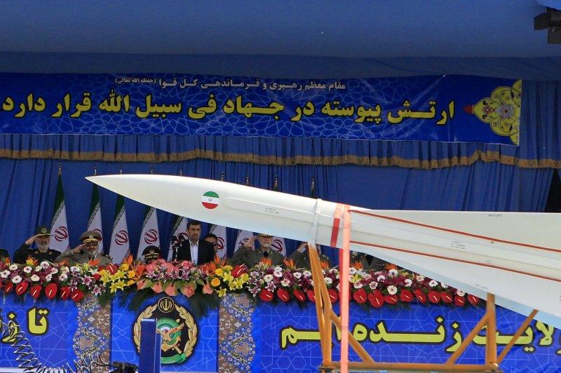 Former Iranian President Mahmoud Ahmadinejad (C) looks at Iranian-made Sejil missile during Army Day parade at the mausoleum of the founder of the Islamic Republic, the late Ayatollah Ruhollah Khomeini in southern Tehran, Iran on April 18, 2013. UPI/Maryam Rahmanian