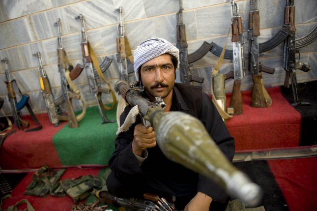 A former Taliban militant holds a weapon handed over to the Afghanistan Reconciliation Commission during a ceremony in Herat, Afghanistan on October 14, 2009. The hand over ceremony is part of a peace-reconciliation program in Herat province. UPI/Hossein Fatemi