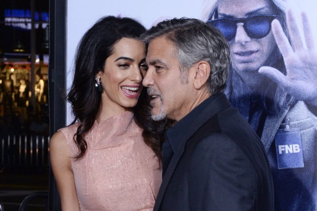 Actor and producer George Clooney and his wife, human rights attorney Amal Alamuddin Clooney attend the premiere of the motion picture dramatic comedy Our Brand Is Crisis at the TCL Chinese Theatre in the Hollywood section of Los Angeles on Oct. 26, 2015. Photo by Jim Ruymen/UPI