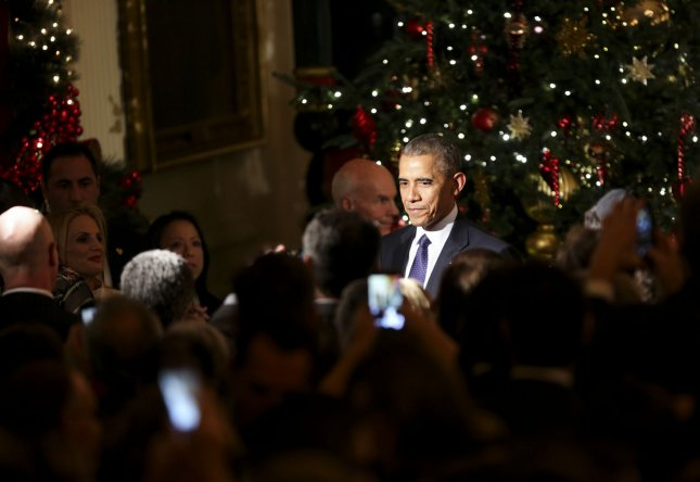 President Barack Obama attended a Hanukkah celebration at the White House on Wednesday, choosing not to sign legislation extending the Iran Sanctions Act, allowing the bill to automatically become law. Pool Photo by Aude Guerrucci/UPI