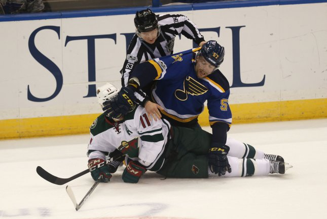 Linesman Trent Knorr tries to seperate St. Louis Blues David Perron from Minnesota Wild Zach Parise in the first period at the Scottrade Center in St. Louis on April 16, 2017. Photo by Bill Greenblatt/UPI
