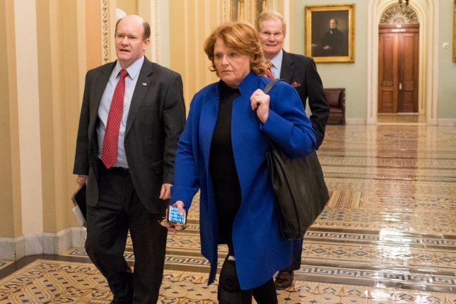 Sen. Heidi Heitkamp, D-N.D., foreground, was elected in 2012 by the narrowest of margins, due in part to the state's Native American population. File Photo by Erin Schaff/UPI