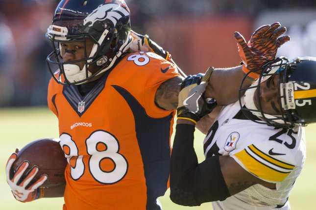 Former Denver Broncos wide receiver Demaryius Thomas (88) stiff arms ex-Pittsburgh Steelers cornerback Brandon Boykin on an 11-yard reception in the first quarter during the AFC Divisional Round on January 17, 2016 at Sports Authority Field at Mile High in Denver. File photo by Gary C. Caskey/UPI
