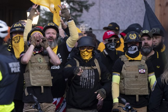 Members of the Proud Boys shout at a pro-Trump rally in Washington, D.C., on December 12, 2020. The groups leader, Henry Enrique Tarrio, pleaded guilty on Monday to burning a Black Lives Matter banner that night. File Photo by Kevin Dietsch/UPI