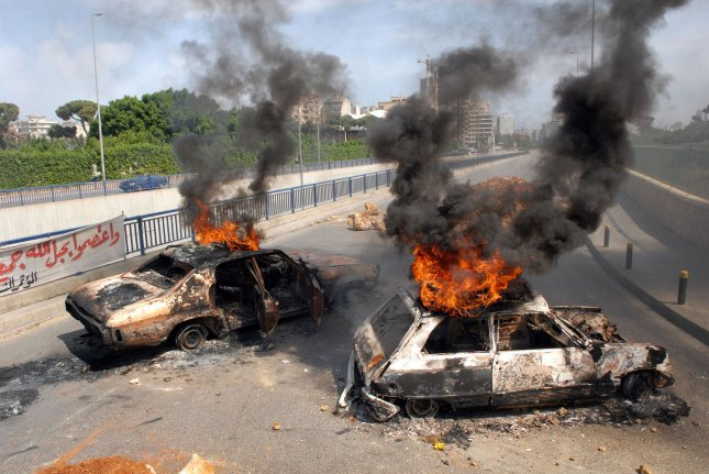 Protesters, allied to LebanonÕs Hezbollah-led political opposition, burn tires, old cars and block streets in the capital Beirut on May 7, 2008. A general labor strike was called for by labor unions demanding pay increases. Sporadic gun-fire was heard throughout the capital as well as clashes between rival political groups. The airport was also closed. (UPI Photo)