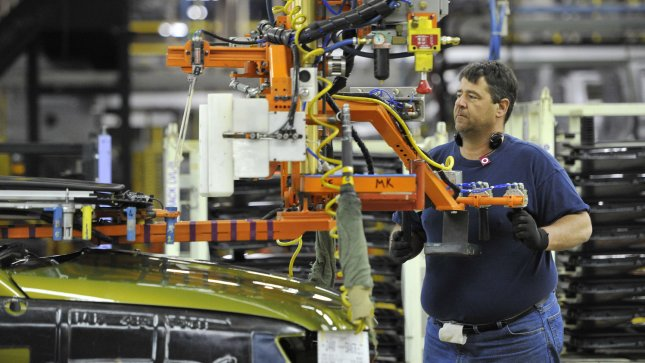 A worker installs a sunroof assembly on a car at an Illinois plant. According to a new poll, job creation is a top priority issue for voters. UPI/Brian Kersey