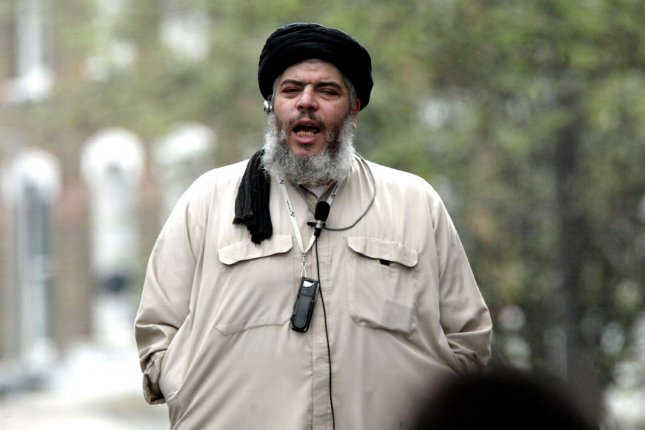 Radical Muslim leader Sheikh Abu Hamza delivers his Islamic message at traditional Friday prayers on the street outside London's Finsbury Mosque on April 16, 2004. UPI Photo/Hugo Philpott