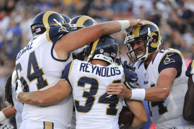 Los Angeles Rams Chase Reynolds,center, is congratulated by quarterback Sean Mannion and teammates after he scored a touchdown against the Dallas Cowboys in the second half of a preseason game at the Los Angeles Coliseum on August 13, 2016. The Rams won 28 to 24. Photo by Lori Shepler/UPI