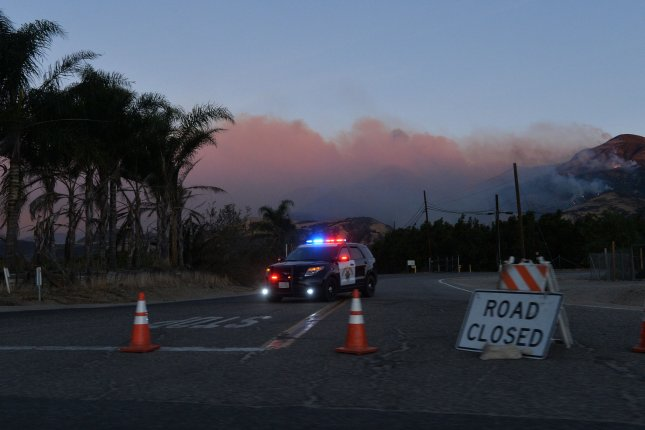 The Thomas Fire burns near Fillmore, Calif., on December 8, 2017. Fire-blackened areas in parts of Southern California have prompted officials to issue evacuation orders ahead of a strong winter storm. File Photo by Jim Ruymen/UPI