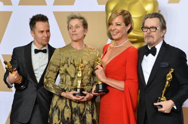 (L-R) Actors Sam Rockwell, Frances McDormand, Allison Janney and Gary Oldman pose backstage with their awards at the Oscars in Los Angeles on March 4. A proposed Oscar category for popular film was scrapped Thursday by organizers of the next edition of the awards ceremony. File Photo by Jim Ruymen/UPI