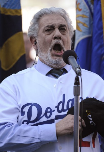 Opera legend Placido Domingo sings the national anthem before a game between the San Francisco Giants and Los Angeles Dodgers at Dodger Stadium in Los Angeles, Calif., in 2011. File Photo by Phil McCarten/UPI