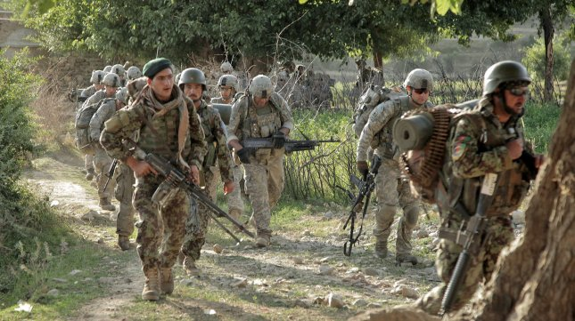 Afghan soldiers and their U.S. counterparts march in Nangarhar province, Afghanistan, on June 14, 2011. During operations in Nangarhar, begining on July 22, Afghan soldiers killed 83 militants. UPI/Tia Sokimson/U.S. Army