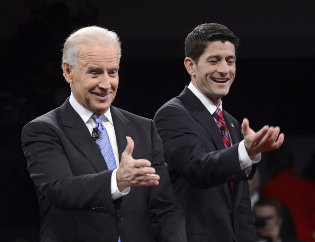 Vice-President Joe Biden (L) and Republican vice president nominee Paul Ryan stand on stage at their debate at Centre College Oct. 11 in Danville, Kentucky.. UPI/Michael Reynolds POOL