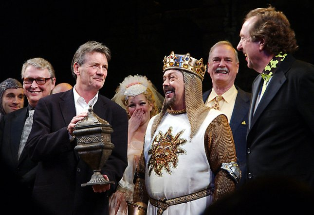 (left to right) Director Mike Nichols looks on as Monty Python member Michael Palin holds a symbolic urn representing deceased Python member Graham Chapman, actor Tim Curry and Python members John Cleese and Eric Idle (shows composer/lyrcist) take part in the opening night curtain call bows on March 17, 2005 for the Monty Python Broadway musical Spamalot directed by Mike Nichols. (UPI Photo/Ezio Petersen)