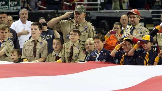 Cub Scouts and Boy Scouts hold an oversized American flag during ceremonies honoring veterans before the New York Jets-St. Louis Rams football game at the Edward Jones Dome in St. Louis on November 18, 2012. UPI/Bill Greenblatt
