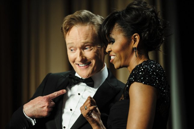 Comedian Conan O'Brien and First Lady Michelle Obama mug for the cameras during the White House Correspondents' Association (WHCA) in Washington, DC on April 27, 2013. UPI/Pete Marovich/Pool