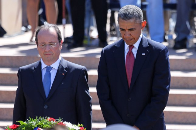 French President Francois Hollande (L) and U.S. President Barack Obama stand at a memorial wreath during a French-American bilateral ceremony commemorating the 70th anniversary of the D-Day landings in the Normandy region of France at the Normandy American Cemetery in Colleville-sur-Mer to on June 6, 2014. File Photo by David Silpa/UPI