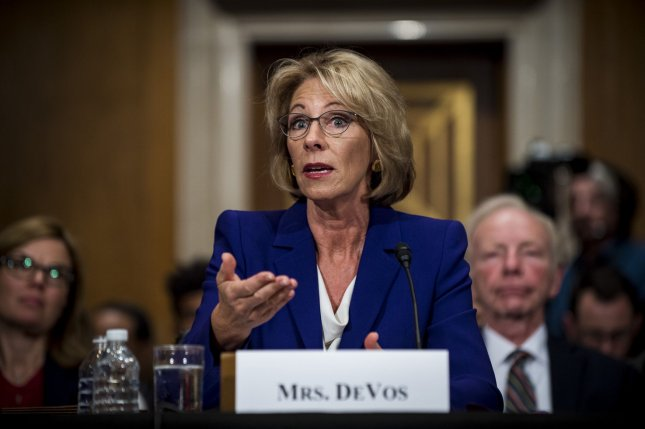 Betsy DeVos, here testifying before the Senate committee on Health, Education, Labor and Pensions during her confirmation hearing on January 17, was confirmed Tuesday by the committee. Democrats on the Senate Finance Committee walked out of Tuesday's session before a vote on Rep. Tom Price, R-Ga, as health and human services secratary, and Steven Mnuchin as treasury secretary, could be taken. Photo by Pete Marovich/UPI
