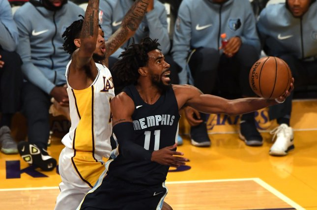 Mike Conley and the Memphis Grizzlies face the Phoenix Suns on Sunday. Photo by Jon SooHoo/UPI